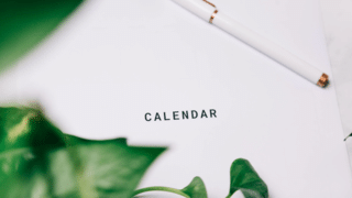 Printed Calendar Behind Greenery