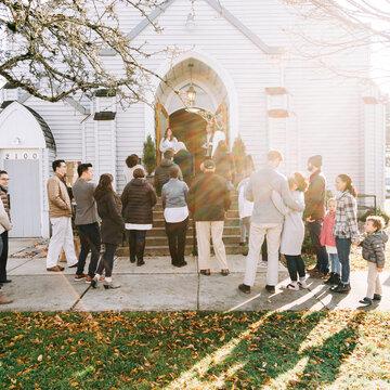 Congregation Members Walking into Church