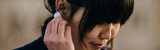 Woman Putting in Headphones