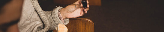 Woman Holding Communion