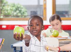 black boy giving a apple