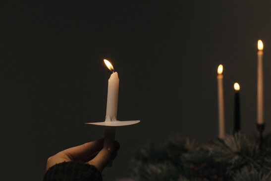 Hand Holding a Candle for a Christmas Candlelight Service