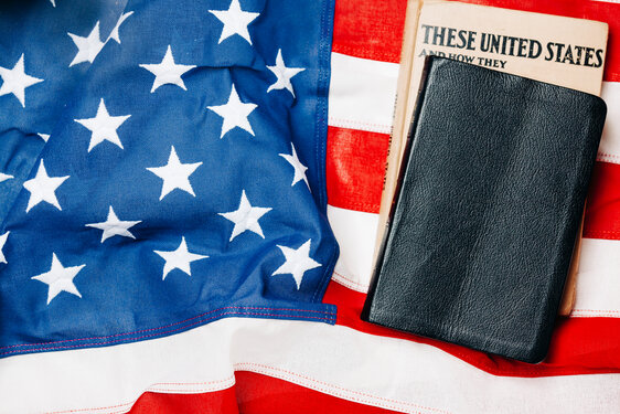 Bible and U.S. History Book on the American Flag