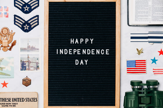 Happy Independence Day Letter Board Surrounded by Vintage USA Paraphernalia
