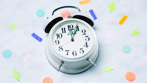 Clock Striking Midnight with Confetti