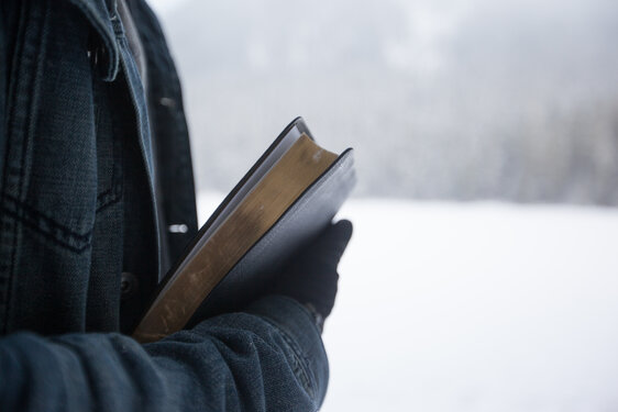 Winter Wonderland Bible in arms in snow