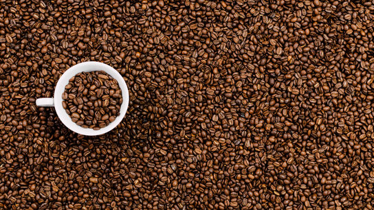 Coffee beans with coffee mug