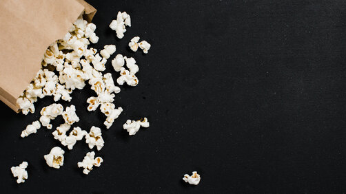 Popcorn in brown paper bag