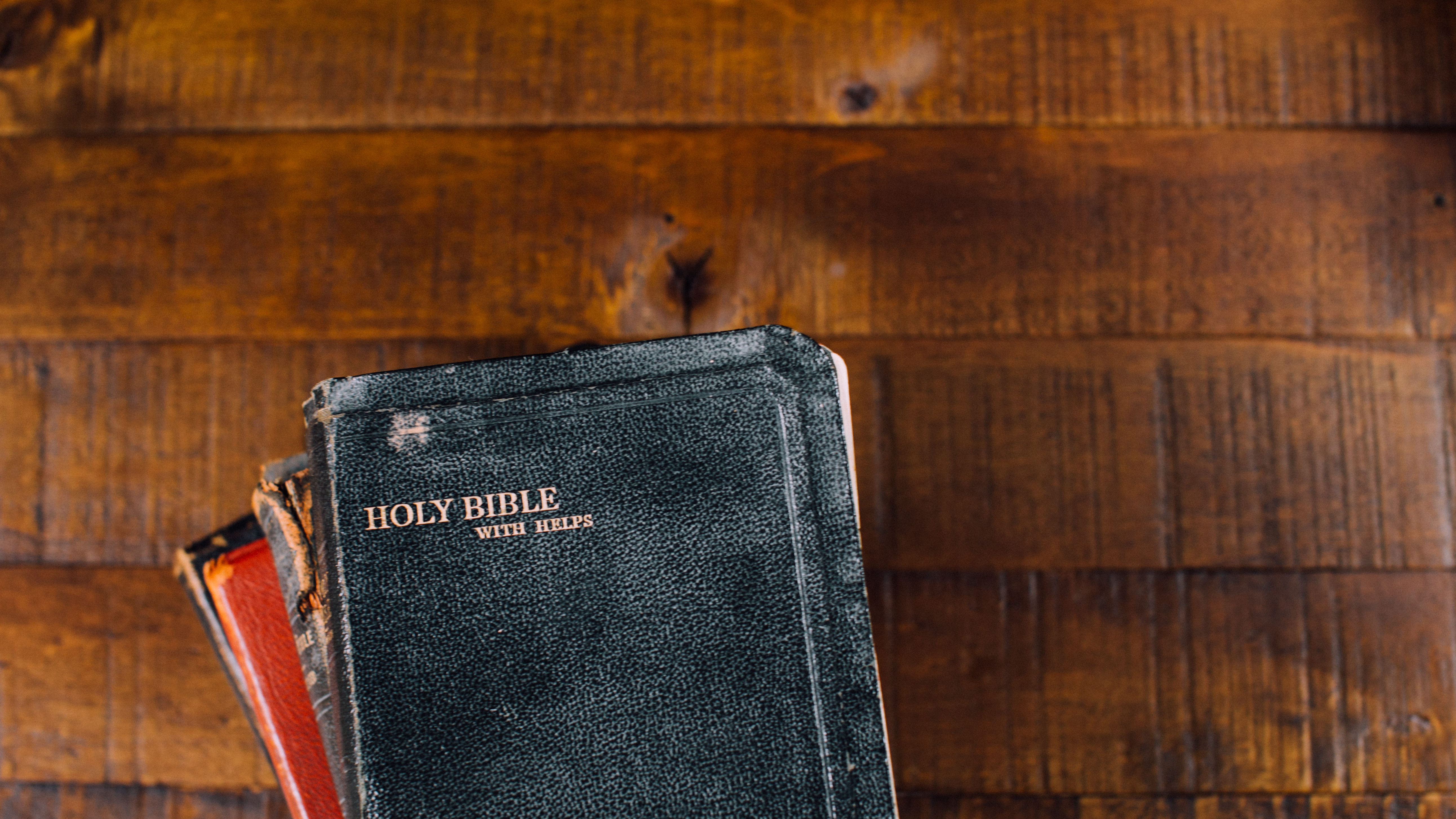Stack of Bibles on wood