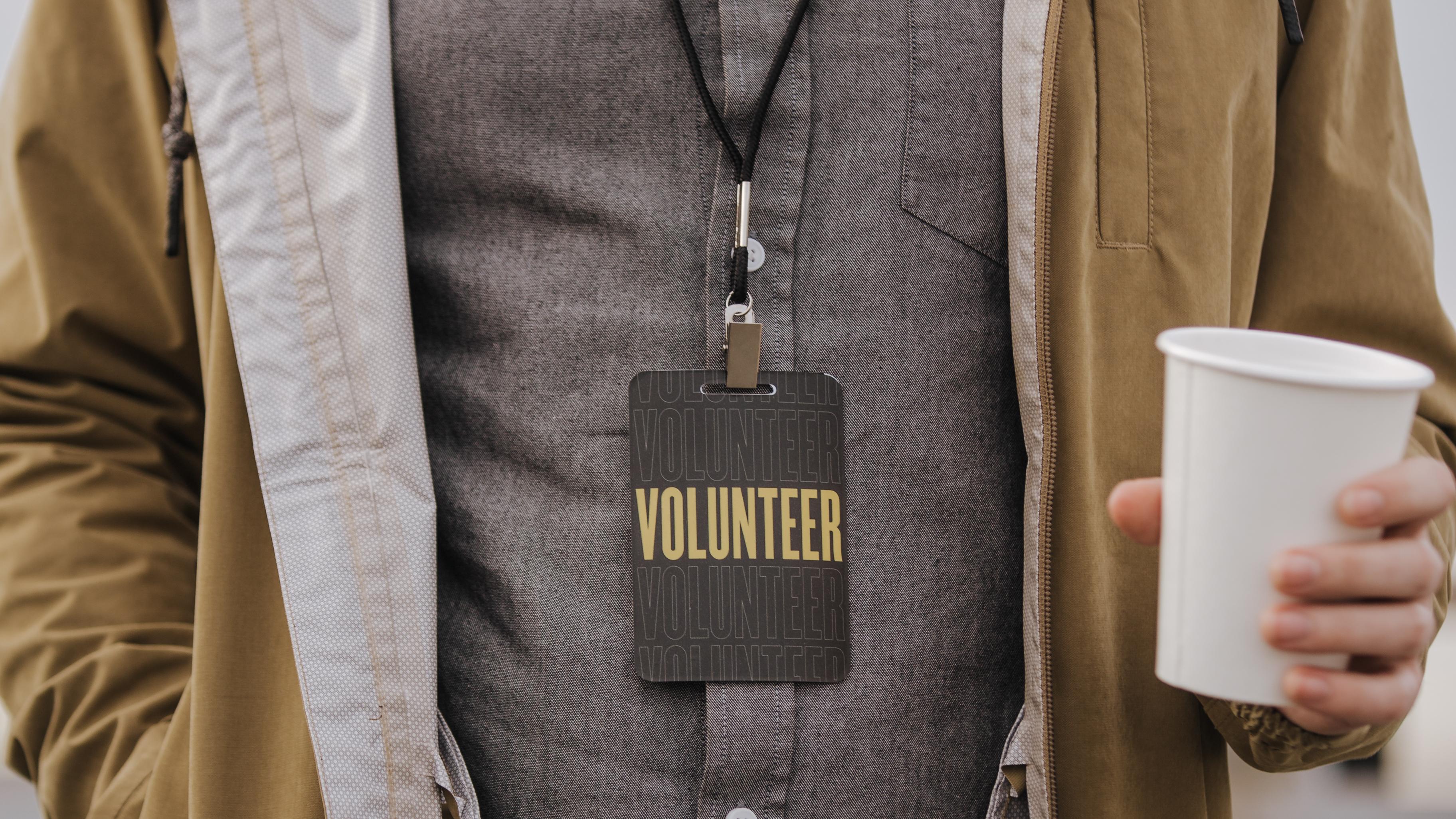 Man in Volunteer Badge