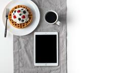 Breakfast waffle and ipad 16x9 ad87df9a 1de6 4d1d b8f7 d7659a1eec35 image