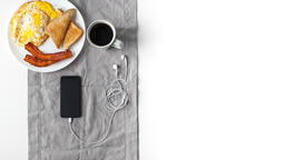 Breakfast and phone 16x9 4fa559af 73f8 4ac6 b21d f3722bd14baf image