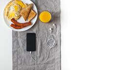 Breakfast and phone 16x9 d67060df a566 4b98 b2e9 4f9aa4826336 image