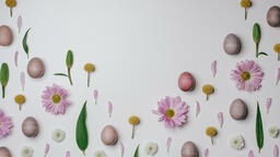 Colorful Eggs with Flowers purple easter flatlay 16x9 e6c7ad41 9df1 443d a03c ffcfd8941afb image