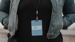 Church Lifestyle woman in welcome badge 16x9 6173381e 3f4e 452b ad23 d7e40a1fc0f5 image