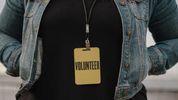 Church Lifestyle woman in volunteer badge 16x9 278c2843 57df 4b08 8113 8c5078f90010 image