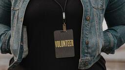 Church Lifestyle woman in volunteer badge 16x9 13eb17bc e785 464a 874a 633a434ed087 image