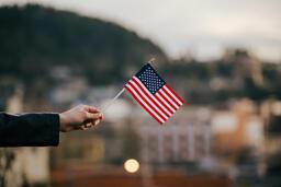 Patriotic Holidays hand in frame holding an american flag 16x9 0935ed34 6ae8 4414 b1ed 76ba375baae1 PowerPoint image