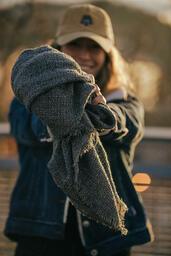 Clothing Drive woman holding out a warm scarf 16x9 500e7a70 f6ae 4805 94a8 b1ef341e070e image