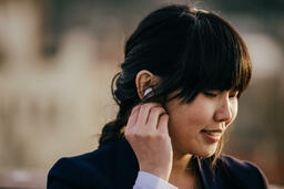 Technology woman putting in air pods 16x9 174e3407 c370 4e29 9350 1c49d1c1e602 PowerPoint image