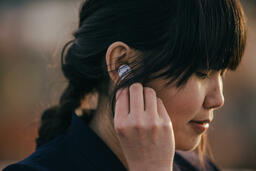 Technology woman putting in air pods 16x9 2ffa4517 718d 488b bcea 8c018922ab65 PowerPoint image