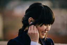 Technology woman putting in air pods 16x9 69d0e7e0 7c13 4d5e bdd0 f601bc822344 PowerPoint image