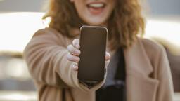 Technology woman holding out a smart phone 16x9 a3de4464 6f4b 4424 83e1 11d7d932ec87 PowerPoint image