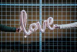 Valentine's Day Lifestyle couple holding love balloon 16x9 49415109 1eb1 4097 8e29 8372da4c448c PowerPoint image