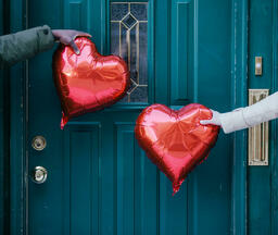 Valentine's Day Lifestyle couple holding heart balloons 16x9 7246e9cb 6bc2 4de6 932a 196657130912 image