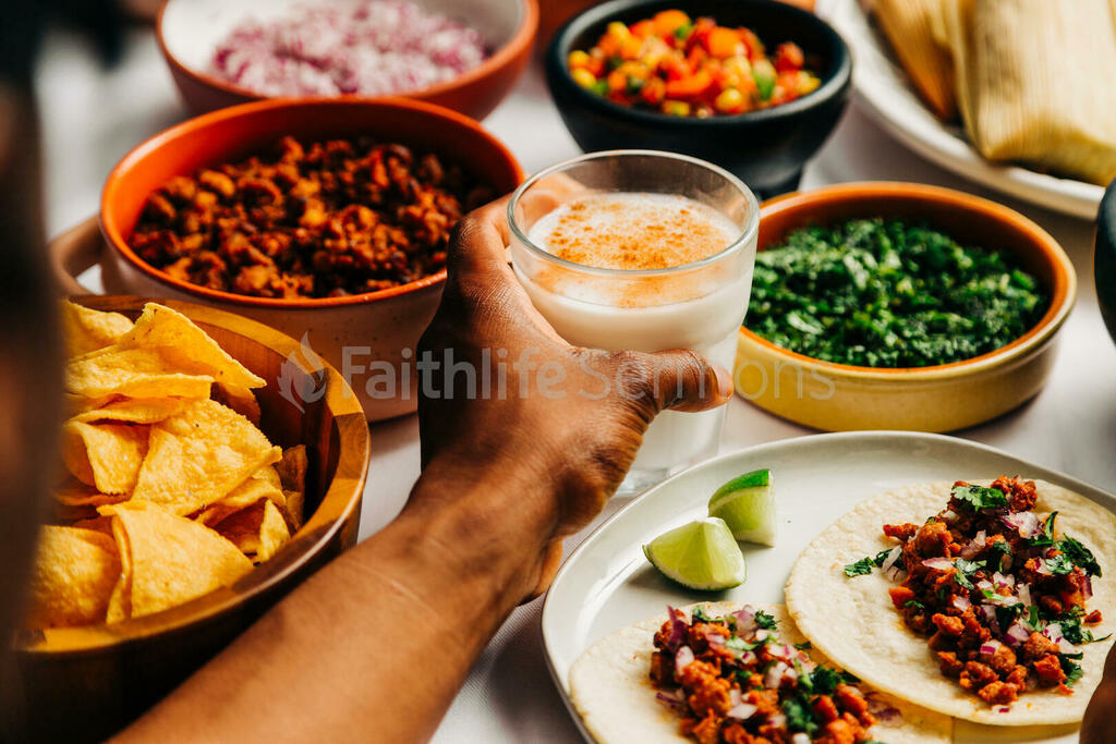 Mexican Food Spread hand holding glass of horchata 16x9 b8f3a04a 5371 4a44 a78c 59d6d50d64e7 preview