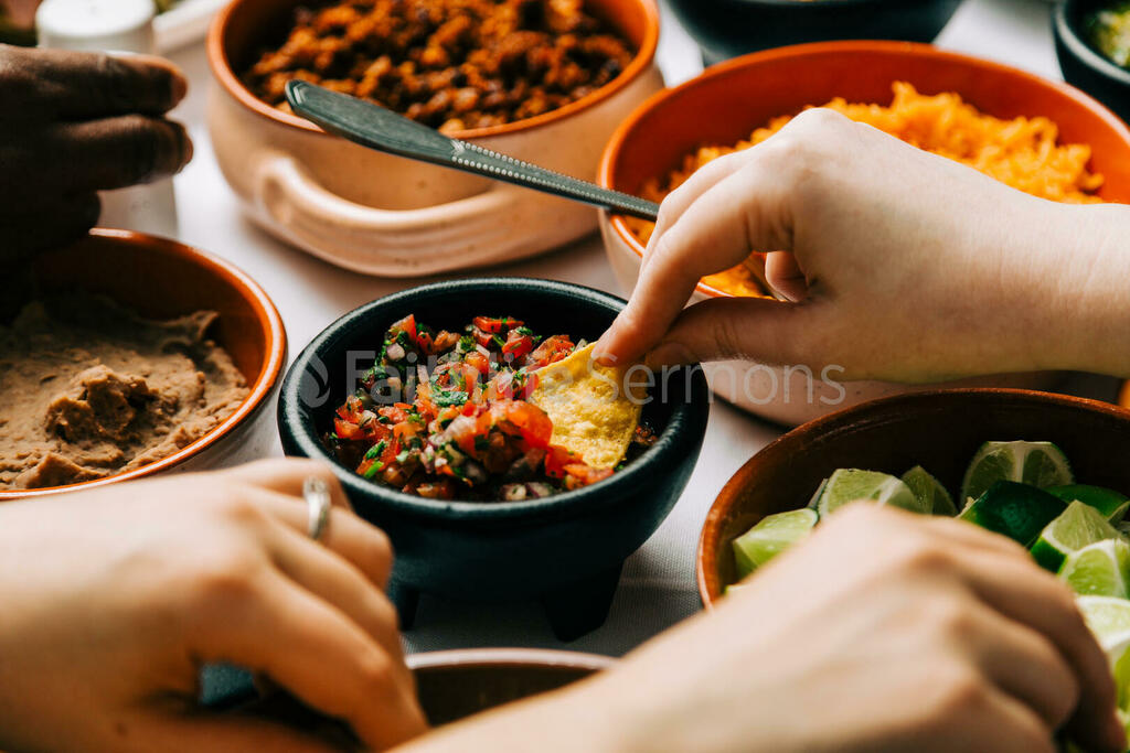 Mexican Food Spread hand dipping chip in salsa 16x9 6f328e89 92ae 4284 a387 de293d901208 preview