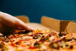 Pizza Boxes hand grabbing a slice of 16x9 1b419847 f2b5 4df6 b772 5cfebeec65d4 image