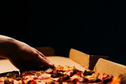 Pizza Boxes hand grabbing a slice of 16x9 c780c78c 954e 47d9 ac99 528ad4813083 image
