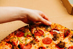 Pizza Boxes hand grabbing a slice of 16x9 a97431a5 7555 43f5 bbc8 38a55882ca82 image