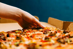 Pizza Boxes hand grabbing a slice of 16x9 52fcafb1 157c 41f4 9187 be1d3cb794e8 image