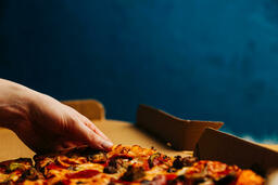 Pizza Boxes hand grabbing a slice of 16x9 14d877b3 9480 4b49 a49a b9dad327283c image