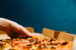 Pizza Boxes hand grabbing a slice of 16x9 ee318fb8 86ae 4a11 84eb 6874a1d86388 image
