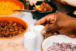 Mexican Food Spread hand grabbing a salt shaker 16x9 bd246b09 b5fb 4c26 9f77 9d26fe74111e image