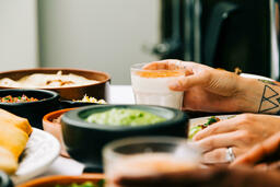 Mexican Food Spread hand holding glass of horchata 16x9 adf6d03e 9e3b 4aa3 9ca8 10458c07f5a7 image