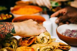 Mexican Food Spread hand grabbing a tamale 16x9 b481c13f 46b6 40c9 bd35 6717481d3d8e image