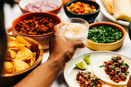 Mexican Food Spread hand holding glass of horchata 16x9 eba870ab e801 4d29 89cd bc2d2c25b354 image