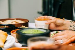 Mexican Food Spread hand holding glass of horchata 16x9 e0043fc3 e979 4b37 b105 5bb7b989a4c2 image