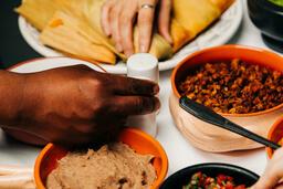Mexican Food Spread hand grabbing a salt shaker 16x9 274e0be6 8a95 43e2 9b54 cae8df893c98 image