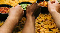 Chips and Salsa hands dipping in 16x9 6a2513d6 a478 489b a22e 86a5f2d2115c image