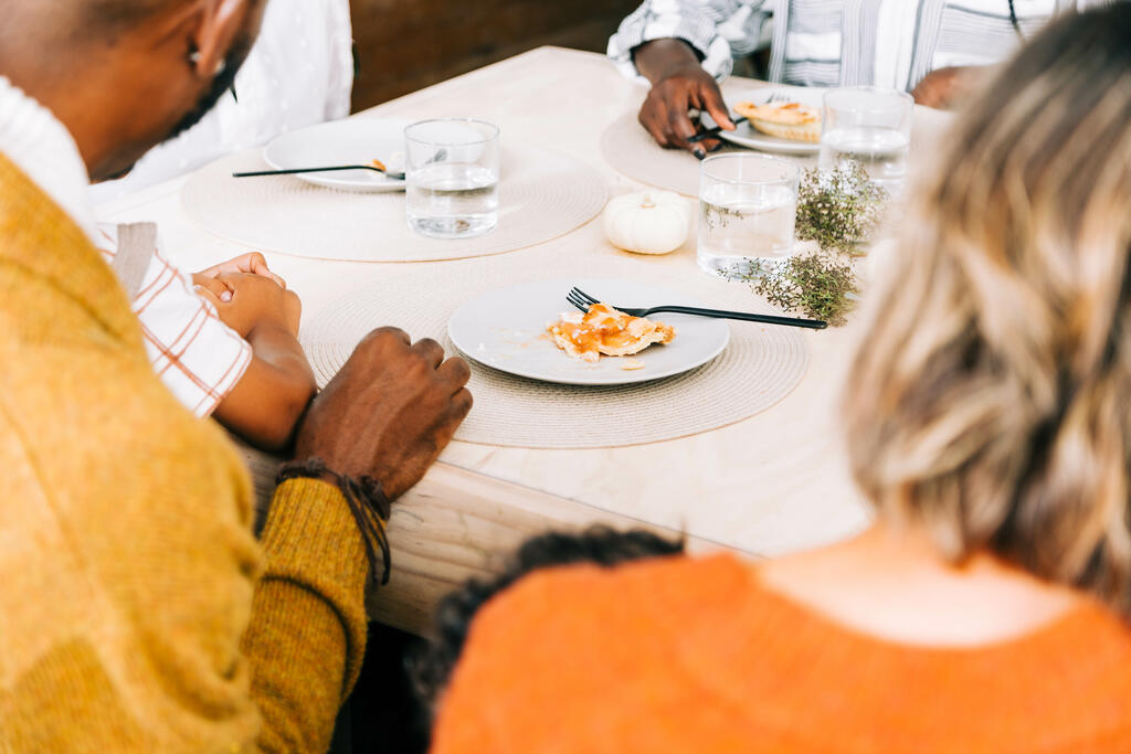 Family Seated at Table for Thanksgiving Dessert large preview