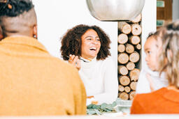 Woman Laughing with Family at the Thanksgiving Table  image 3