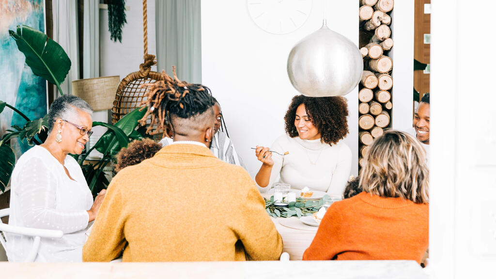 Family Enjoying Thanksgiving Dessert Together large preview
