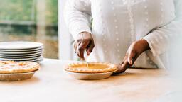 Woman Slicing Pumpkin Pie  image 1