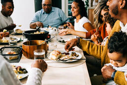 Family Enjoying the Thanksgiving Meal Together  image 1