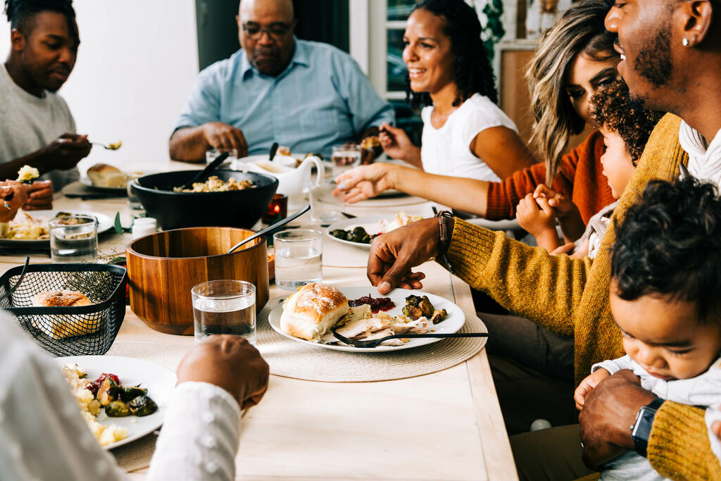Family Enjoying the Thanksgiving Meal Together large preview